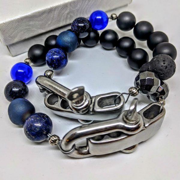 two black and blue bracelets layered on top of each other