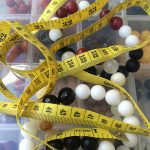 rocks by sekou tape measure on top of beads